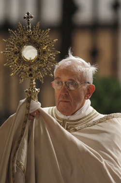 Pope Francis celebrates feast of Corpus Christi outside Rome basilica